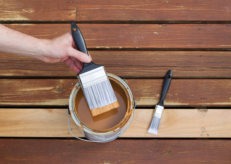 When Should I Stain my New Deck? - Econo Decks - Deck and Fence Services - Featured Image